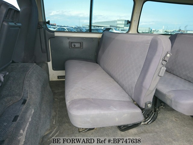 The interior of a used 2011 Nissan Caravan from online used car dealer BE FORWARD.