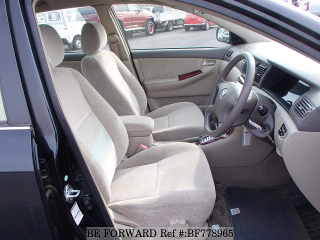 The front interior of a used 2001 Toyota Corolla from online used car exporter BE FORWARD.