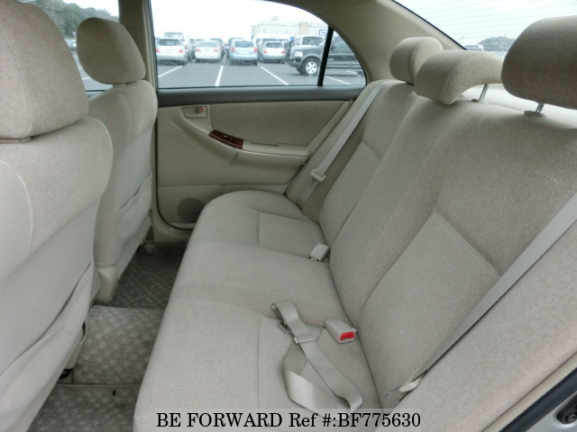 The back interior of a used 2003 Toyota Corolla from online used car exporter BE FORWARD.
