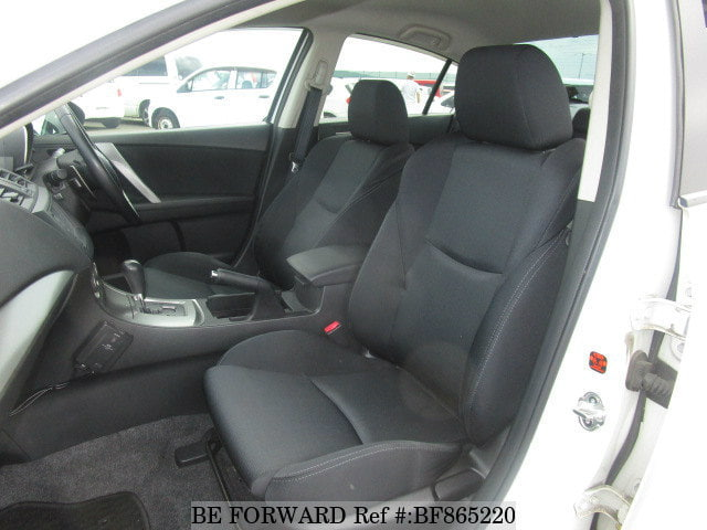 The interior of a used 2011 Mazda Axela from online used car exporter BE FORWARD.