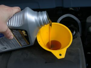 Refilling car with synthetic motor oil
