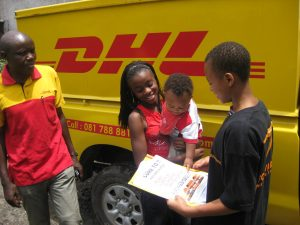 A Ugandan family receiving the documents for their used car purchased with online Japanese used car dealer BE FORWARD.