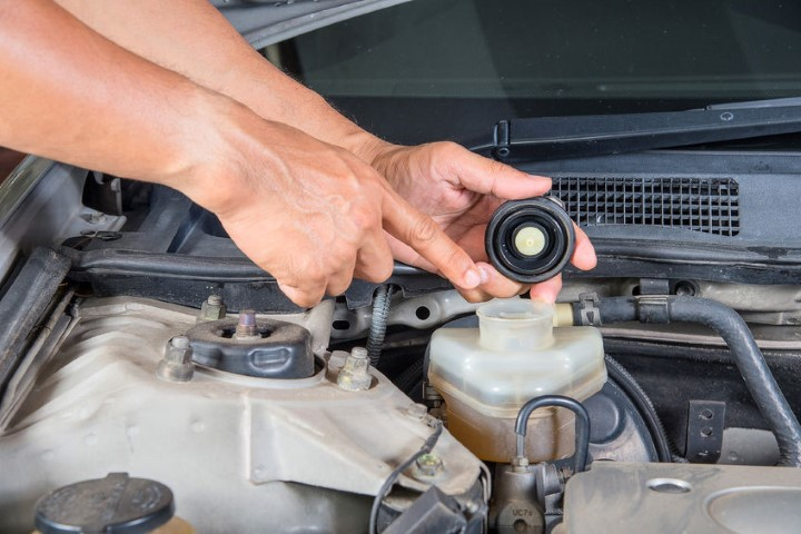 Checking brake fluid, which is also sold on BE FORWARD Auto Parts.