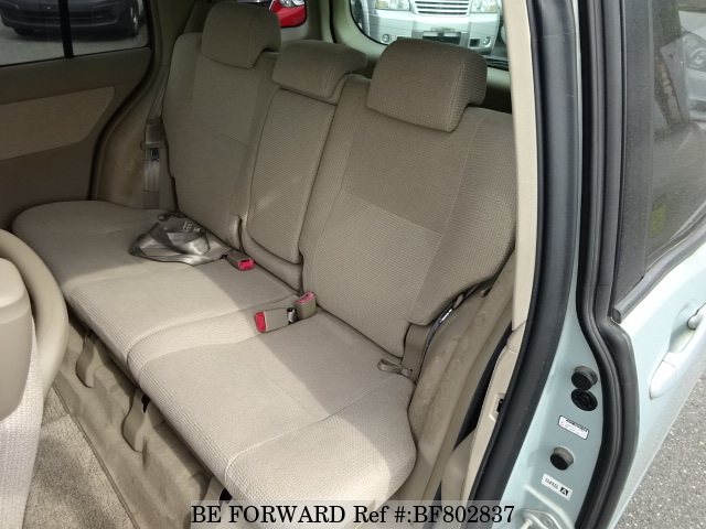 The back interior of a used 2004 Toyota Raum from online used car exporter BE FORWARD.
