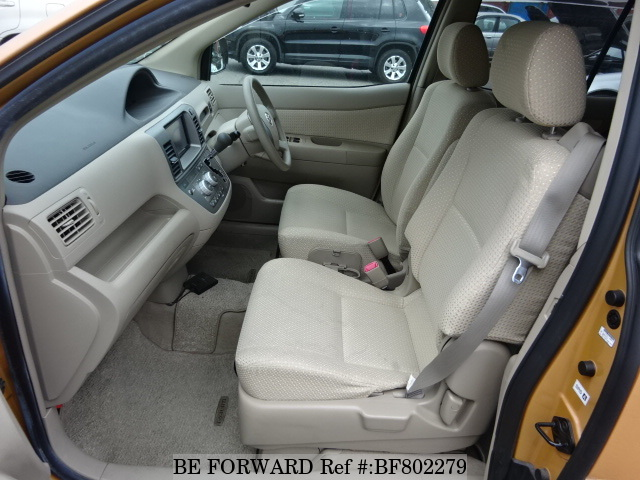 The front interior of a used 2009 Toyota Raum from online used car exporter BE FORWARD.