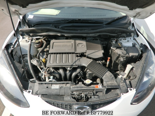 The engine of a used 2011 Mazda Demio