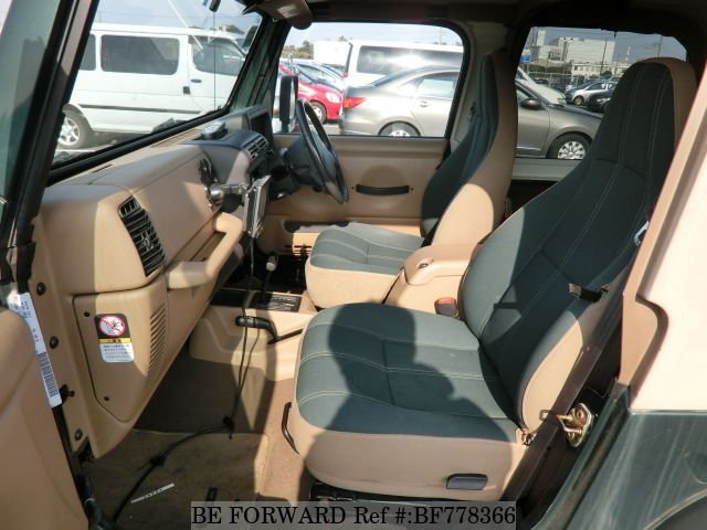 The interior of a used 2001 Jeep Wrangler from online used car exporter BE FORWARD.