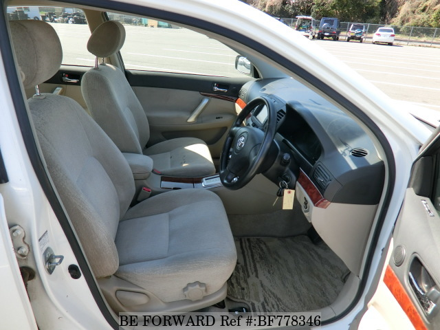 The interior of a used 2003 Toyota Premio from online used car exporter BE FORWARD.
