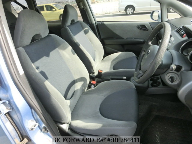 The interior of a used 2004 Honda Fit from online used car exporter BE FORWARD.