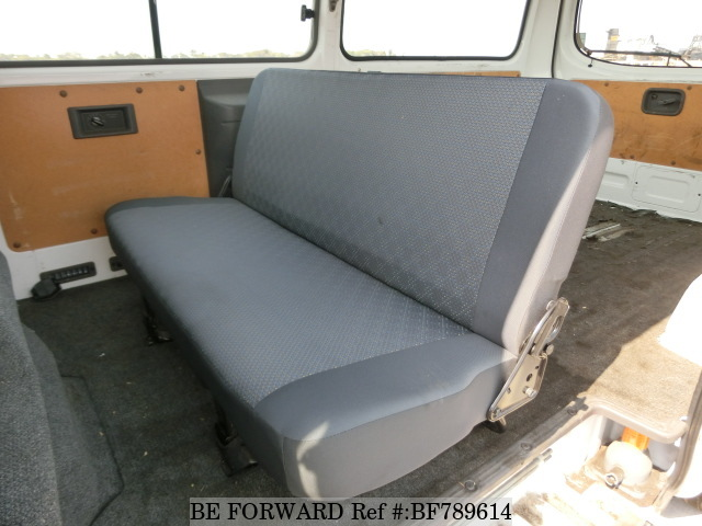 The interior of a used 2012 Nissan Caravan Van from online used car exporter BE FORWARD.