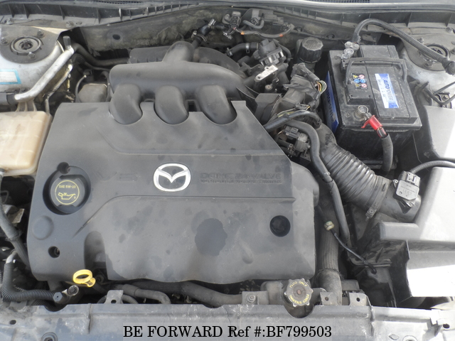 The engine of a used 2002 Mazda Axela from online used car exporter BE FORWARD.