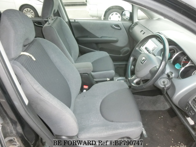 The interior of a used 2003 Honda Fit from online used car exporter BE FORWARD.