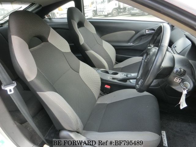 The interior of a used 2004 Toyota Celica from online used car exporter BE FORWARD.