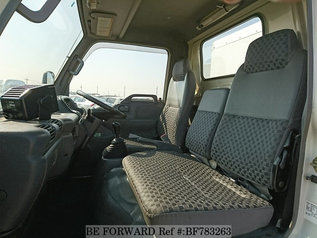 The interior of a used 2005 Isuzu Elf Truck from online used car exporter BE FORWARD.