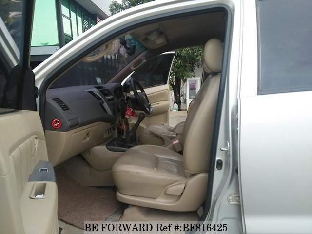 The interior of a used 2011 Toyota Hilux from online used car exporter BE FORWARD.