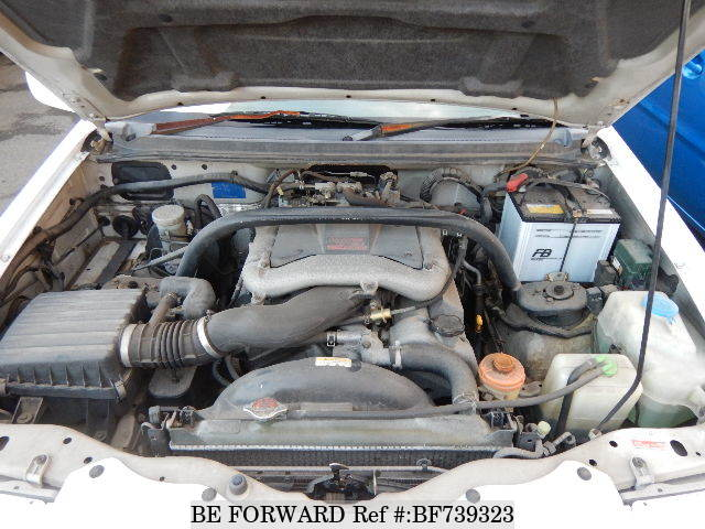 The engine of a used 1999 Suzuki Escudo from used car dealer BE FORWARD.