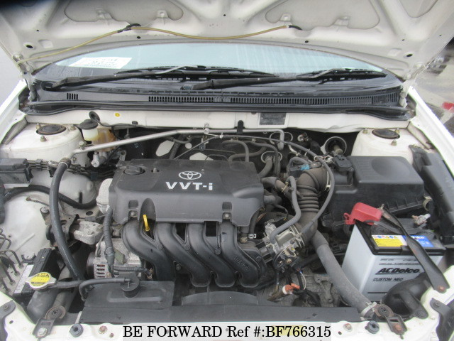 The engine of a used 2003 Toyota Corolla RunX from online used car exporter BE FORWARD.
