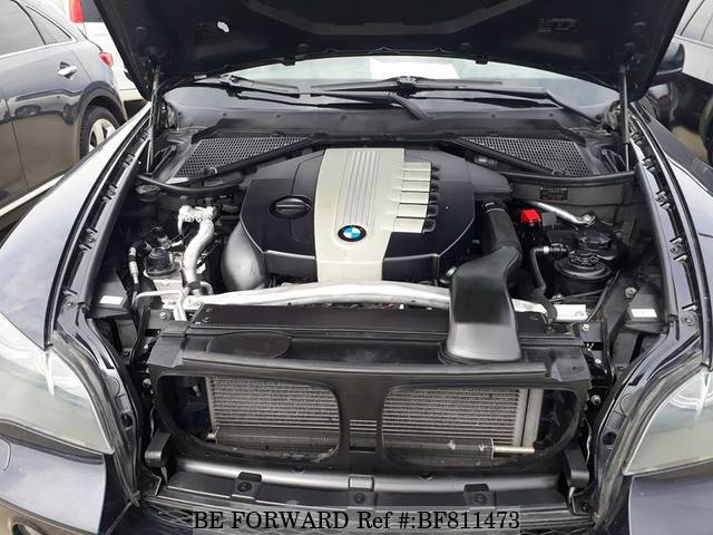 The engine of a used 2010 BMW X5 from online Japanese cars exporter BE FORWARD.