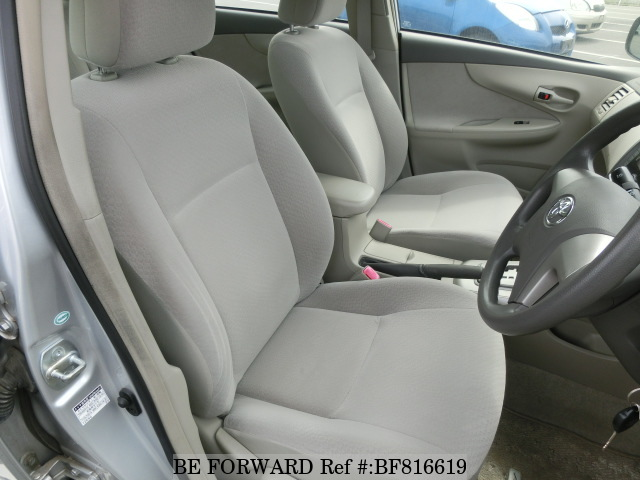 The interior of a used 2011 Toyota Corolla Axio from online used car exporter BE FORWARD.