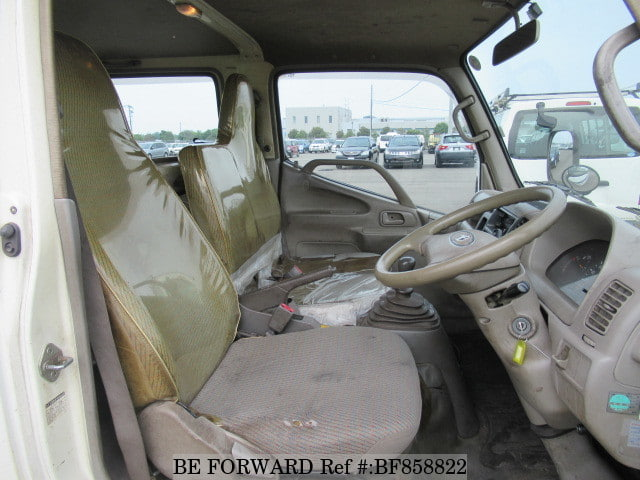 The interior of a used 2004 Toyota Dyna Truck from online used car exporter BE FORWARD.