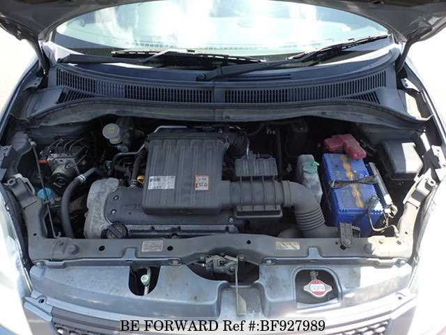 The engine of a used 2007 Suzuki Swift from online used car exporter BE FORWARD.