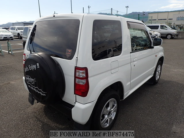 The rear of a used 2009 Mitsubishi Pajero Mini from online used car exporter BE FORWARD.