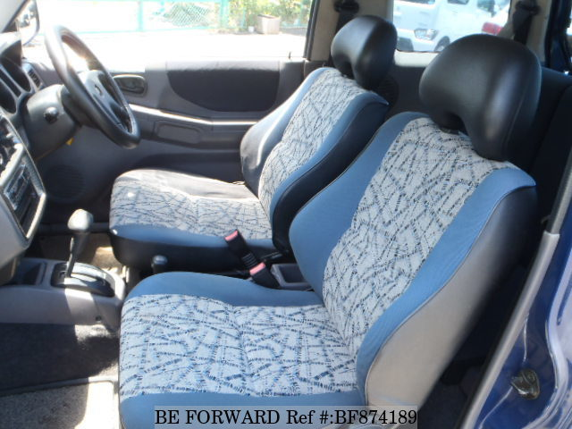 The interior of a used 1995 Mitsubishi Pajero Mini from online used car exporter BE FORWARD.