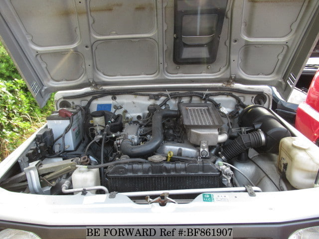 The engine of a used 1996 Suzuki Jimny from online used car exporter BE FORWARD.