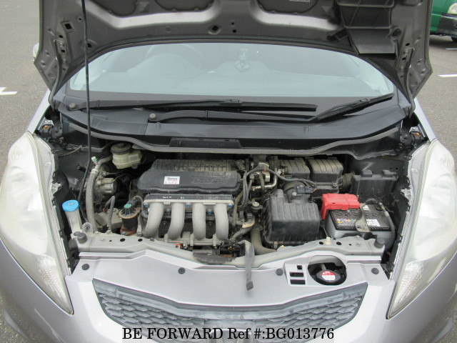 The engine of a used 2009 Honda Fit from online used car exporter BE FORWARD.