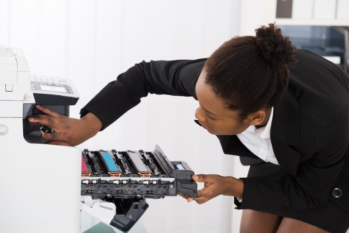 African Woman Using Photocopier - BE FORWARD