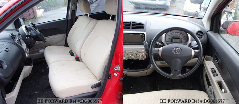 interior of a low cost red fuel efficient used toyota passo hatchback